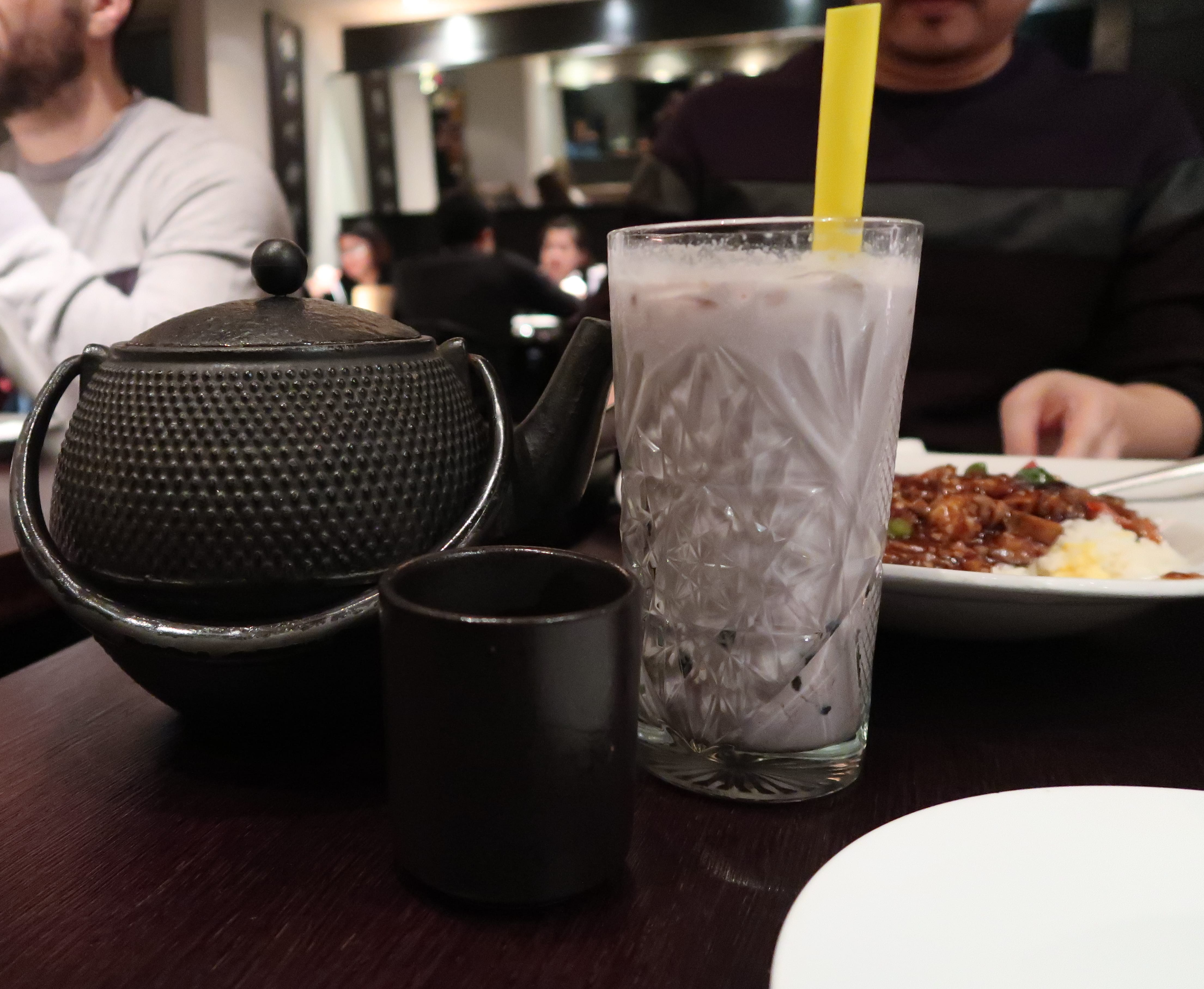 Black teapot with black cup and glass of bubble milk tea