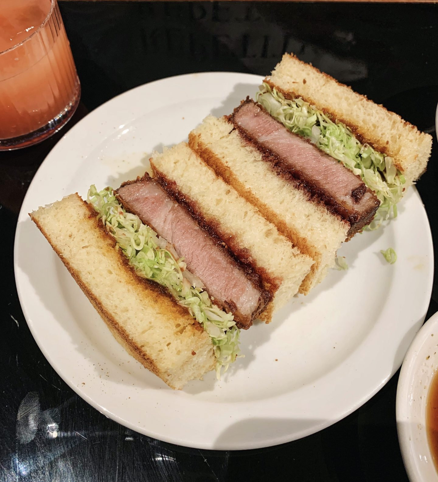 Classic katsu sandwich served sliced on a plate